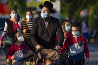 Israelis ordered into quarantine; Palestinians in the West Bank returned to life under lockdown