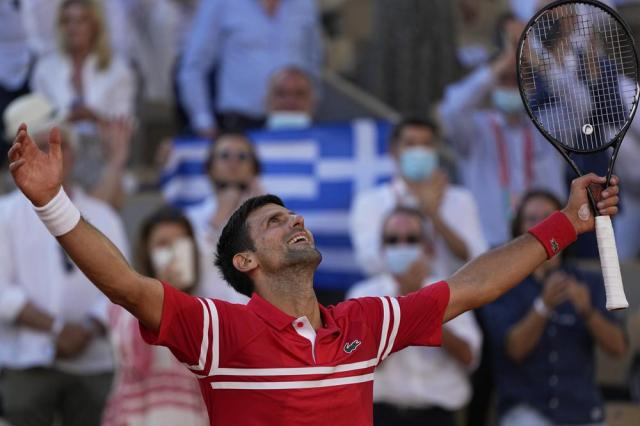 Serbia's Novak Djokovic celebrates after defeating Stefanos Tsitsipas of Greece in their final match of the French Open tennis tournament at the Roland Garros stadium Sunday, June 13, 2021 in Paris. (AP Photo/Michel Euler)