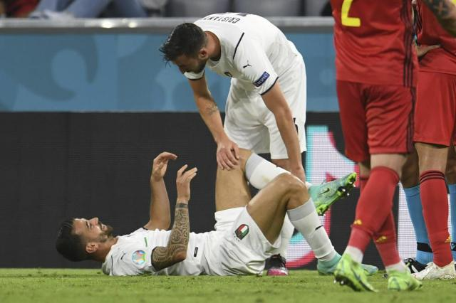 Italy's Leonardo Spinazzola lies on the pitch after an injury during a Euro 2020 soccer championship quarterfinal match between Belgium and Italy at the Allianz Arena in Munich, Germany, Friday, July 2, 2021. (Andreas Gebert/Pool Photo via AP)