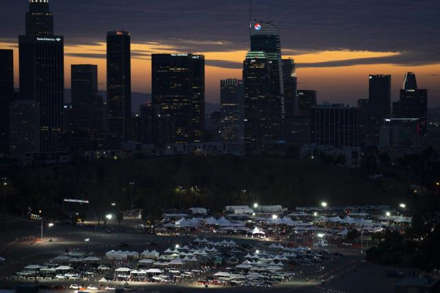FILE - In this Wednesday, Jan. 27, 2021 file photo, motorists line up for COVID-19 vaccinations and testing in the parking lot of Dodger Stadium in Los Angeles. (AP Photo/Jae C. Hong)