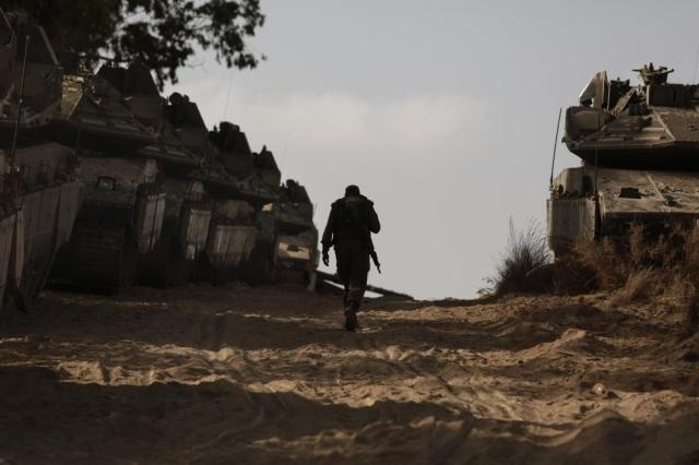 An Israeli soldier walks at a staging ground near the border with the Gaza Strip, in southern Israel, Thursday, May 20, 2021. (AP Photo/Maya Alleruzzo)