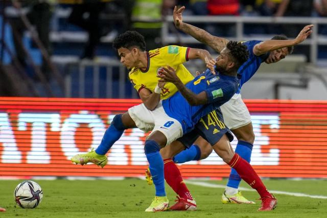 Colombia's Luis Diaz (14) and Brazil's Fred battle for the ball during a qualifying soccer match for the FIFA World Cup Qatar 2022 in Barranquilla, Colombia, Sunday, Oct. 10, 2021. (AP Photo/Fernando Vergara)