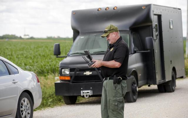 Linn County Sheriff's Office Sgt. Pat Brady pilots a UAV to search for a robbery and shooting suspect in Coggon, Iowa, on Monday, June 21, 2021. A Chicago man who allegedly shot and wounded a sheriff's deputy at an Iowa gas station and then evaded an extensive manhunt for hours has been arrested, a sheriff said Monday. (Jim Slosiarek/The Gazette via AP)