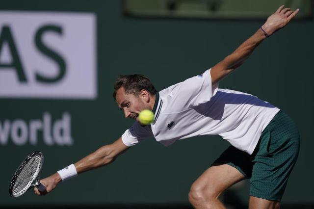 Daniil Medvedev, of Russia, returns a shot to Grigor Dimitrov, of Bulgaria, at the BNP Paribas Open tennis tournament Wednesday, Oct. 13, 2021, in Indian Wells, Calif. (AP Photo/Mark J. Terrill)