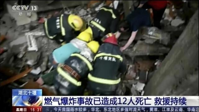 In this image taken from a video footage run by China's CCTV, rescue workers dig for survivors in the aftermath of a gas explosion in Shiyan city in central China's Hubei Province on Sunday, June 13, 2021. At least a dozen people were killed and more seriously injured Sunday after a gas line explosion tore through the residential neighborhood in central China. (CCTV via AP Video)