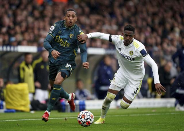 Watford's Joao Pedro, left, and Leeds United's Junior Firpo battle for the ball during the English Premier League soccer match between Leeds United and Watford at Elland Road, Leeds, England, Saturday Oct. 2, 2021. (Mike Egerton/PA via AP)