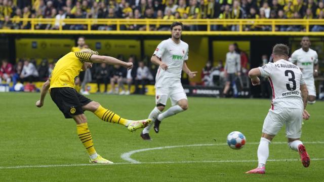 Dortmund's Julian Brandt scores his side's second goal during the German Bundesliga soccer match between Borussia Dortmund and FC Augsburg in Dortmund, Germany, Saturday, Oct. 2, 2021. (AP Photo/Martin Meissner)