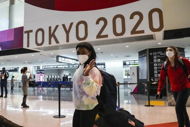 Simone Biles and the U.S. Women's Gymnastics team arrive for the Tokyo 2020 Summer Olympic Games at Narita International Airport Thursday, July 15, 2021, in Narita, east of Tokyo. (AP Photo/Kiichiro Sato)