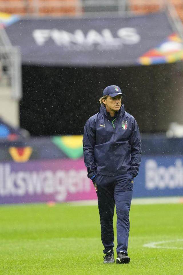 Italy's manager Roberto Mancini attends a training session ahead of Wednesday's UEFA Nations League semifinal soccer match between Italy and Spain, at the Milan San Siro stadium, Italy, Tuesday, Oct. 5, 2021. (AP Photo/Antonio Calanni)