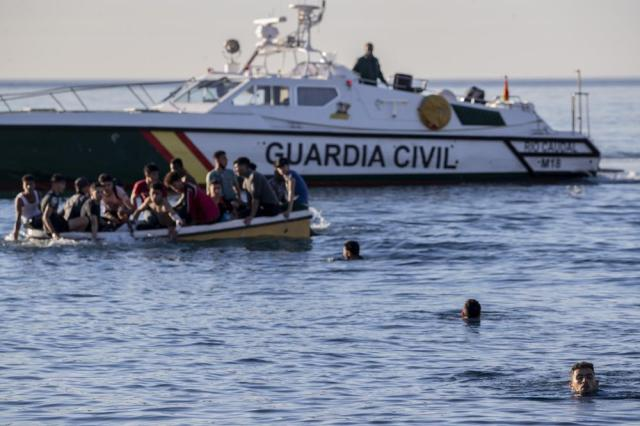 Migrants arrive at the Spanish enclave of Ceuta, near the border of Morocco and Spain, Wednesday, May 19, 2021. Spanish officials are acknowledging for the first time that the unprecedented migrant crisis has been triggered by an angry Rabat at Madrid's decision to provide medical treatment to the militant boss of the Polisario Front. (AP Photo/Bernat Armangue)