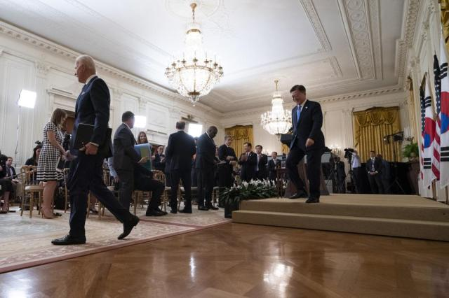 President Joe Biden departs followed by South Korean President Moon Jae-in after a joint news conference, in the East Room of the White House, Friday, May 21, 2021, in Washington. (AP Photo/Alex Brandon)