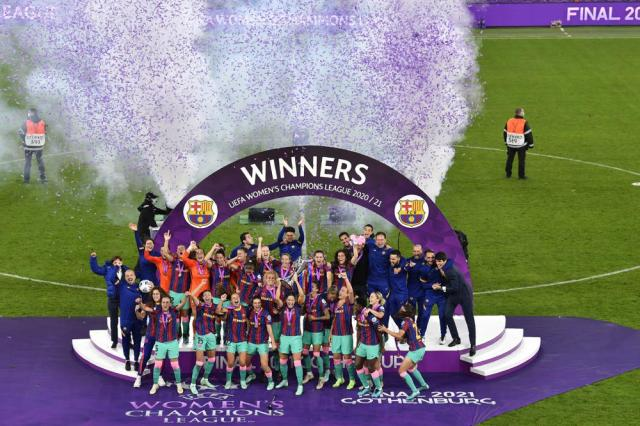 Barcelona players hold the trophy aloft after the UEFA Women's Champions League final soccer match between Chelsea FC and FC Barcelona in Gothenburg, Sweden, Sunday, May 16, 2021. Barcelona won 4-0. (AP Photo/Martin Meissner)