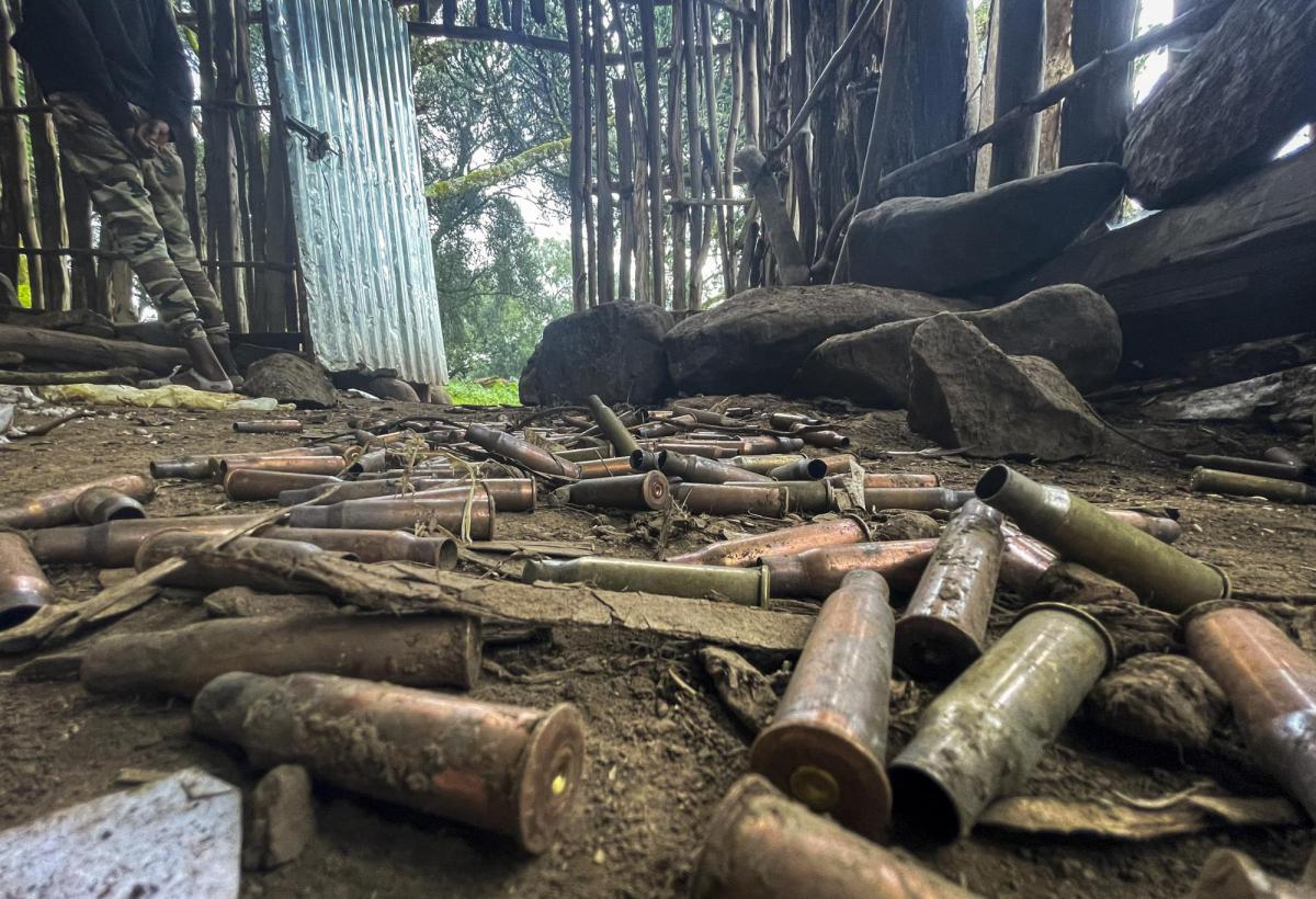 """Spent bullet casings lie scattered on the ground in a hut near the village of Chenna Teklehaymanot, in the Amhara region of northern Ethiopia Thursday, Sept. 9, 2021. At the scene of one of the deadliest battles of Ethiopia's 10-month Tigray conflict, witness accounts reflected the blurring line between combatant and civilian after the federal government urged all capable citizens to stop Tigray forces """"once and for all."""" (AP Photo)"""