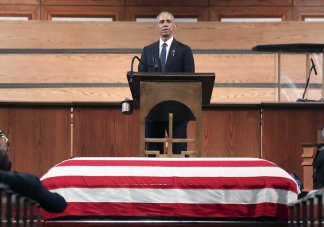 Former president Barak Obama uses John Lewis' funeral to emphasize the need to renew the Voting Rights Act
