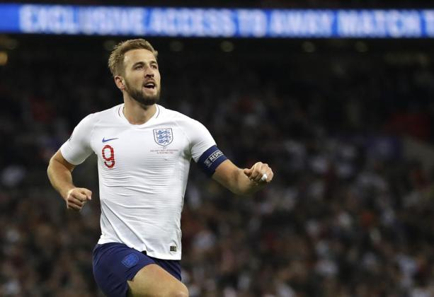 FILE - In this Thursday, Nov. 14, 2019 file photo, England's Harry Kane, right, celebrates scoring the fifth goal during the Euro 2020 group A qualifying soccer match between England and Montenegro at Wembley stadium in London. With a chance to become the all-time top scorer with a national team, Cristiano Ronaldo will highlight the list of top players at this year's European Championship. Others who could make an impact include Kylian Mbappé, Robert Lewandowski, Kevin De Bruyne and Harry Kane. (AP Photo/Kirsty Wigglesworth, File)