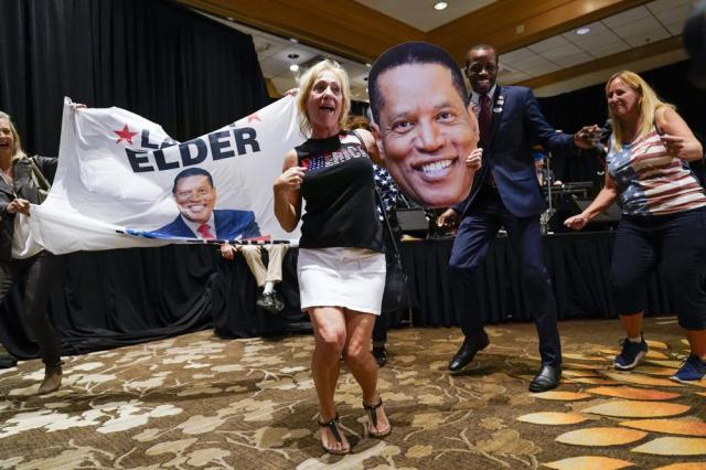 Supporters of republican conservative radio show host Larry Elder gather as polls close for the California gubernatorial recall election Tuesday, Sept. 14, 2021, in Costa Mesa, Calif. The rare, late-summer election, which challenged California Governor Gavin Newsom, has emerged as a national battlefront on issues from COVID-19 restrictions to climate change. (AP Photo/Ashley Landis)