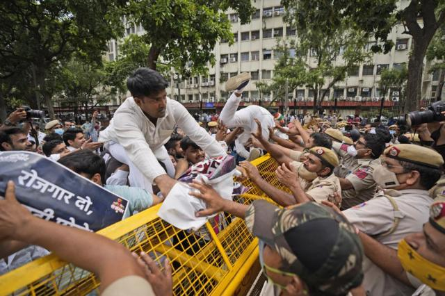 Indian Youth Congress members try to breach a police barricade during a protest held to mark Indian Prime Minister Narendra Modi's birthday in New Delhi, India, Friday, Sept.17, 2021. Youth members of main opposition Congress party clashed with police during a street protest Friday demanding jobs as the country's economy recovered from the impact of the COVID-19 pandemic that triggered massive unemployment in the country. The march took place as supporters of Prime Minister Narendra Modi celebrated his birthday as he turned 71 on Friday. (AP Photo/Manish Swarup)