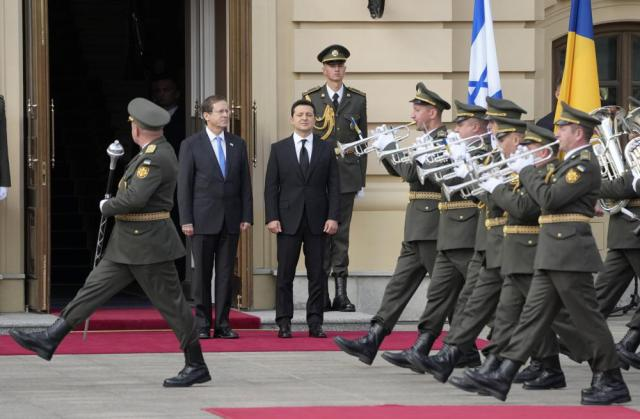 Ukrainian President Volodymyr Zelenskyy, centre right, and Israeli President Isaac Herzog review the honor guard during a welcome ceremony ahead of their meeting in Kyiv, Ukraine, Tuesday, Oct. 5, 2021. (AP Photo/Efrem Lukatsky)