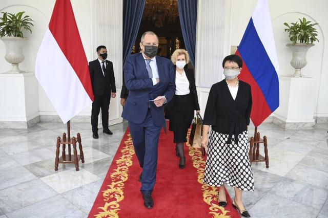 In this photo released by the Indonesian Ministry of Foreign Affairs, Russian Foreign Minister Sergei Lavrov, center, walks with his Indonesian counterpart Marsudi, right, after their meeting in Jakarta, Indonesia, Tuesday, July 6, 2021. Russia's top diplomat expressed his backing for Southeast Asian efforts toward achieving peace in Myanmar on his visit Tuesday to Indonesia to demonstrate the region's importance to Moscow. (Ministry of Foreign Affairs via AP)
