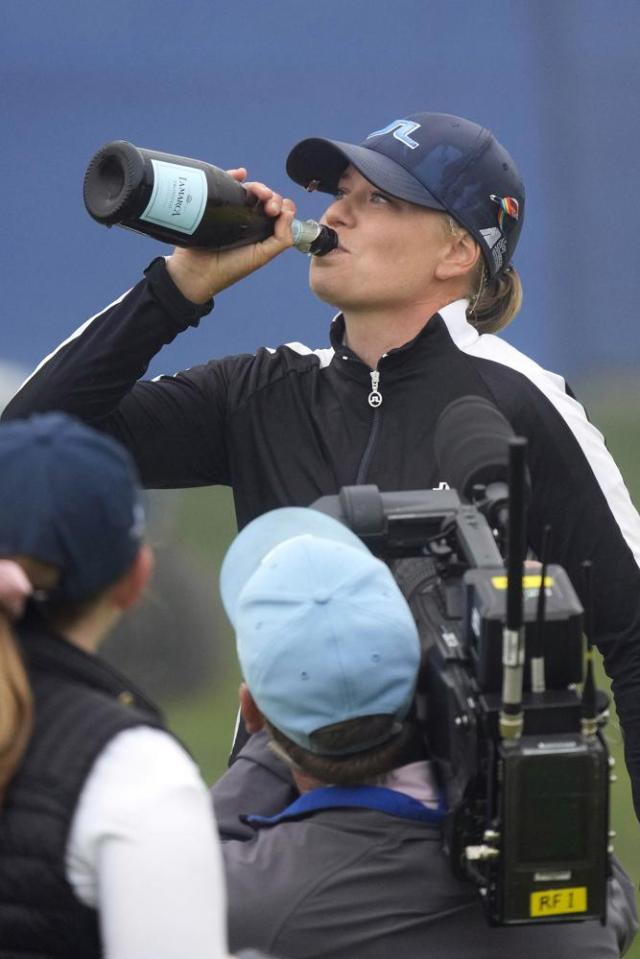 Matilda Castren, of Finland, drinks prosecco on the 18th green at the Lake Merced Golf Club after winning the LPGA Mediheal Championship golf tournament, Sunday, June 13, 2021, in Daly City, Calif. (AP Photo/Tony Avelar)