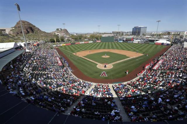 FILE - In this March 5, 2019, file photo, fans fill most of the seats at Tempe Diablo Stadium, the Los Angeles Angels' spring stadium ballpark, during the team's spring training baseball game against the Chicago Cubs in Tempe, Ariz. The Angels will keep their spring training home in Tempe until at least 2035, after reaching a deal for an extensive renovation of Tempe Diablo Stadium. (AP Photo/Elaine Thompson, File)