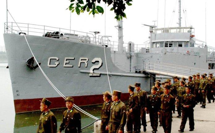 North Korean soldiers look at the USS Pueblo in 2006. (Korean Central News Agency/Korea News Service via AP)
