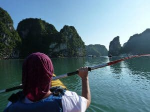 Halong Bay in Vietnam as seen from a kayak. The kayaker in front is wearing a High Uv Buff® as legionnaire style cap. Submitted to us as part of a testimonial. Copyright unknown