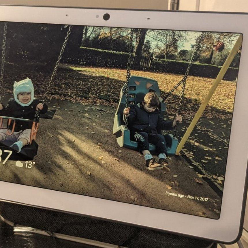 photo of a Next Hub Max displaying a photo of two children on swings
