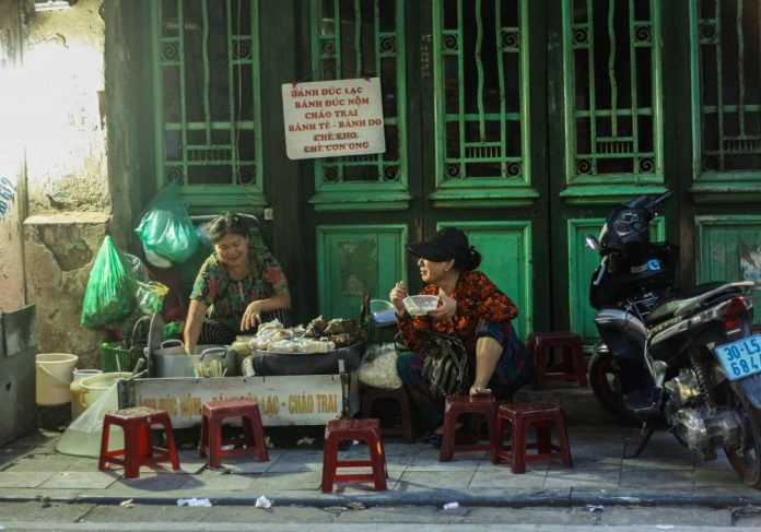eating food on the pavement hanoi