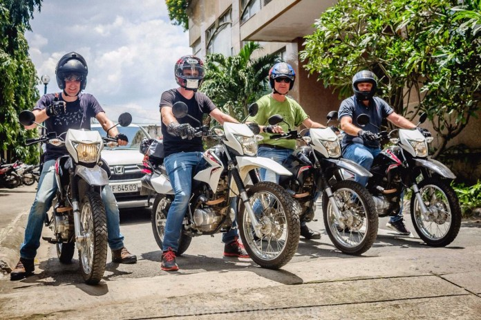 Riders posing by their motorbikes offered by TIGIT