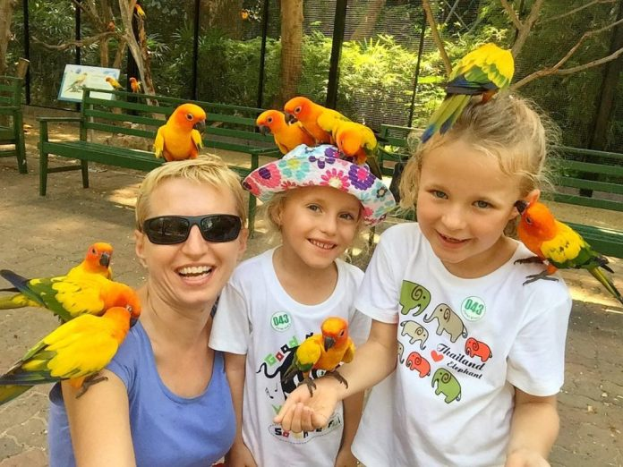 A mom and her 2 little daughters hanging out at the Safari World Bangkok