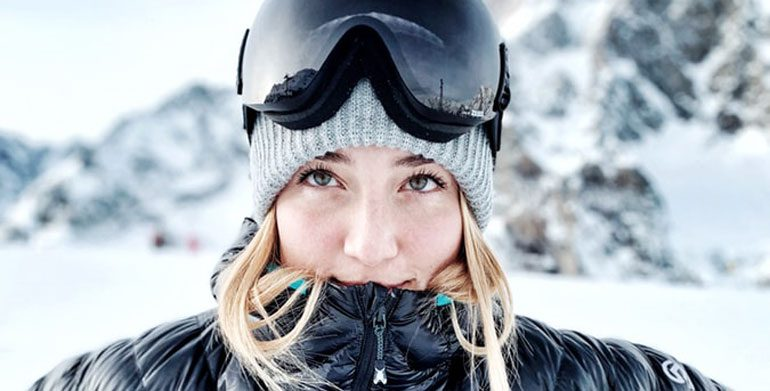 portrait of woman dressed for skiing
