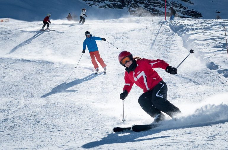 family of skiers enjoying alpine skiing