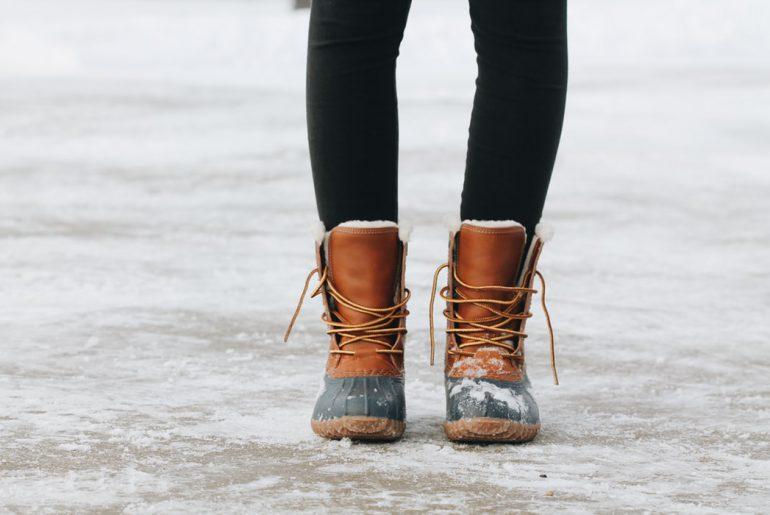 winter boots on slippery ski resort pavement