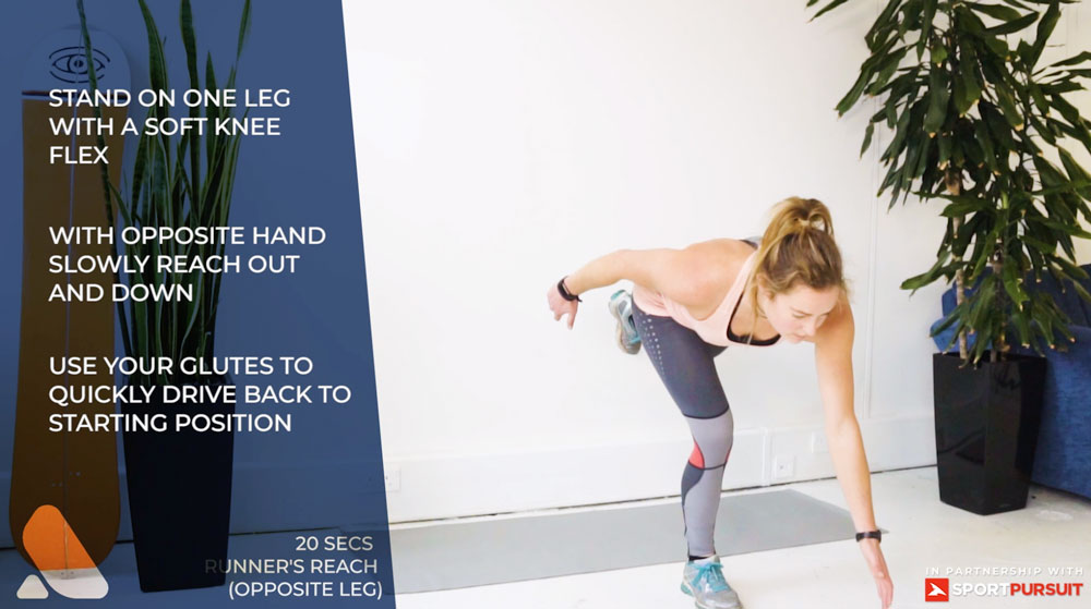 woman performs ski fitness exercise - runner's reach