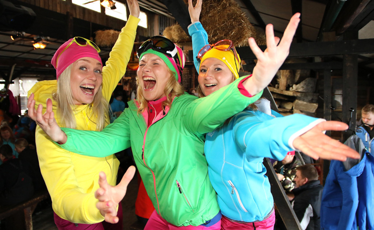 group of girls in bright clothing at apres ski