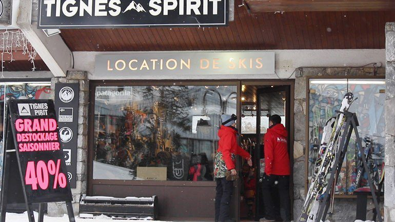 Two people entering ski shop for sales shopping