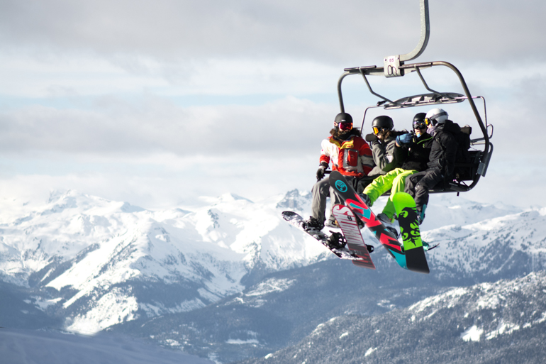 group of snowboarders on chair lift