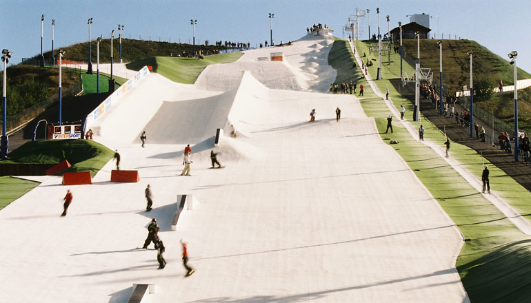 skiers and snowboarders on dry ski slope