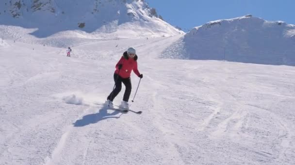 Woman skiing on groomed slope