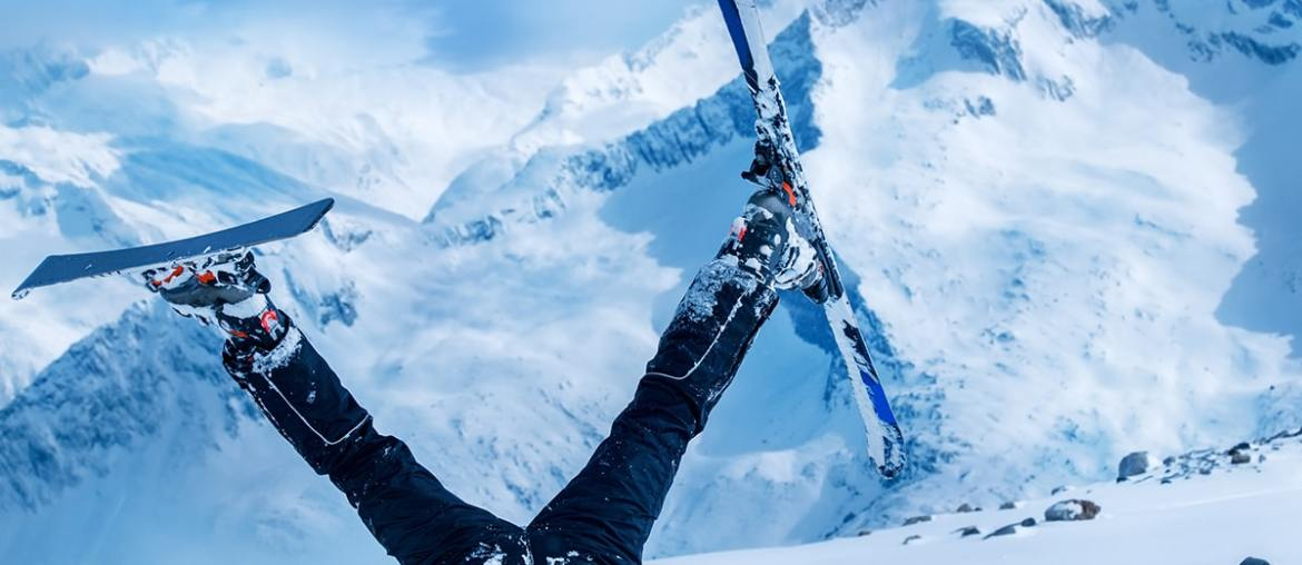 skier stuck in snow with legs in air