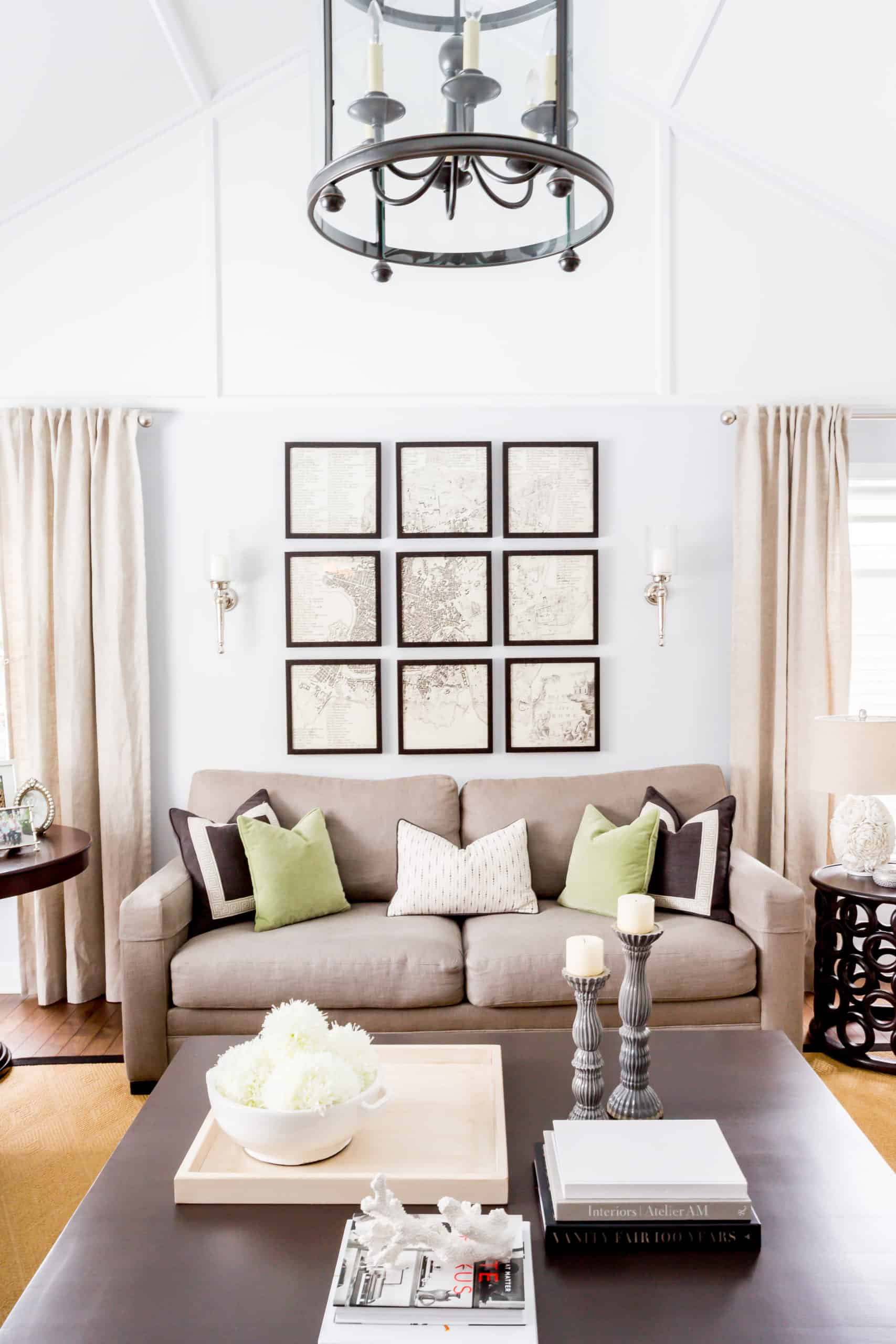 Gray couch with nine pictures above it