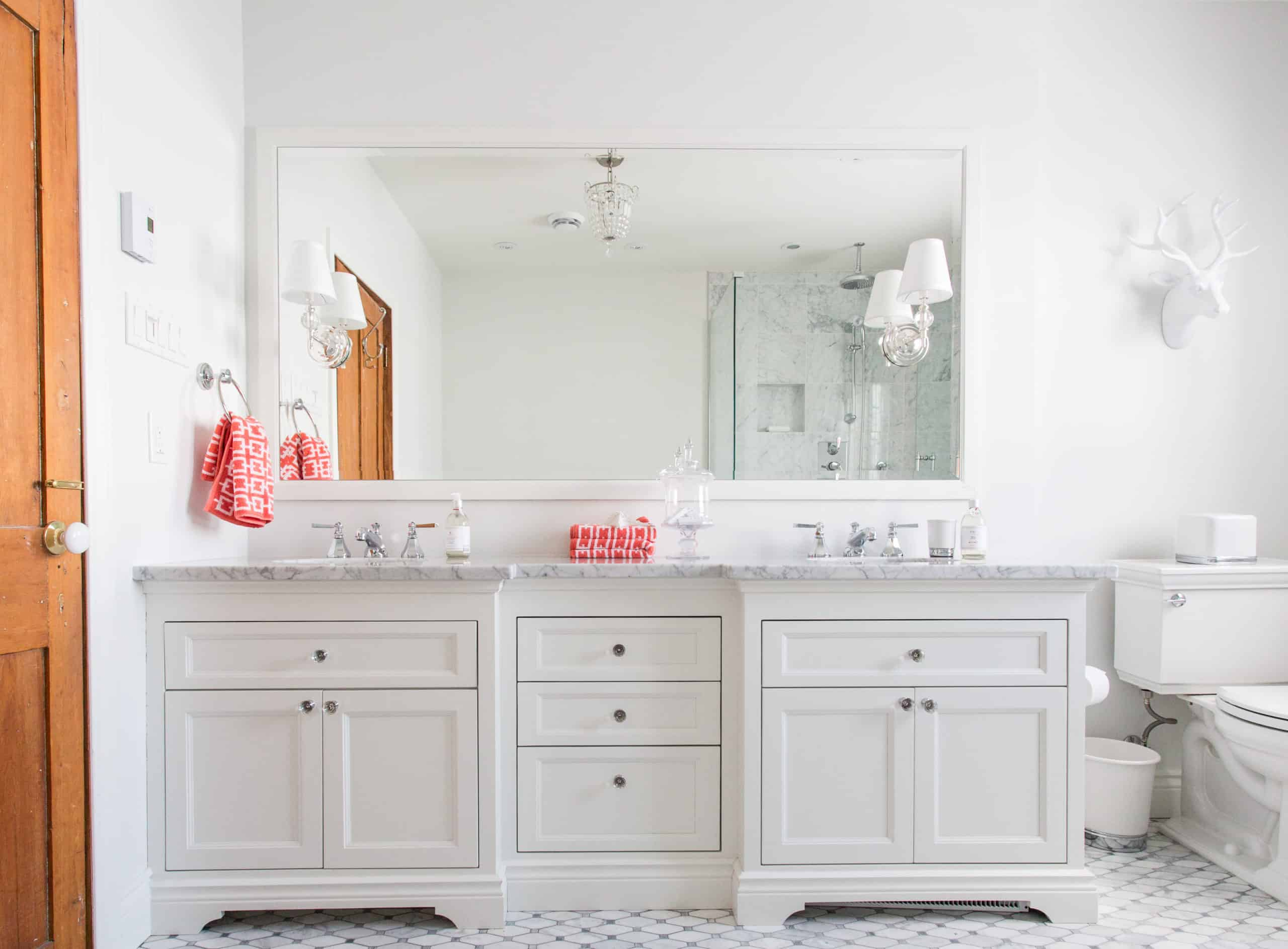 White double vanity with a marble countertop