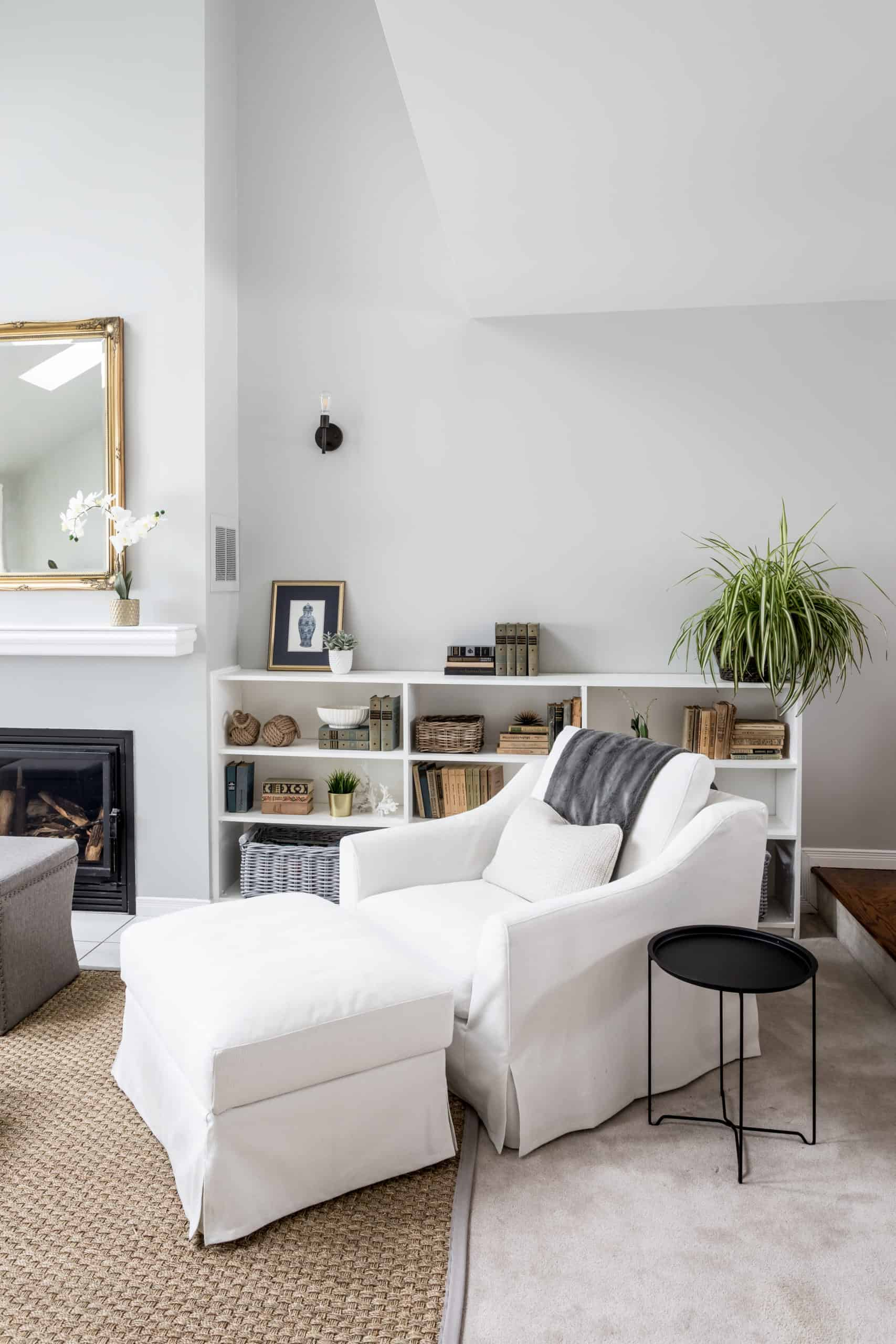 Bright white chair with an ottoman next to it