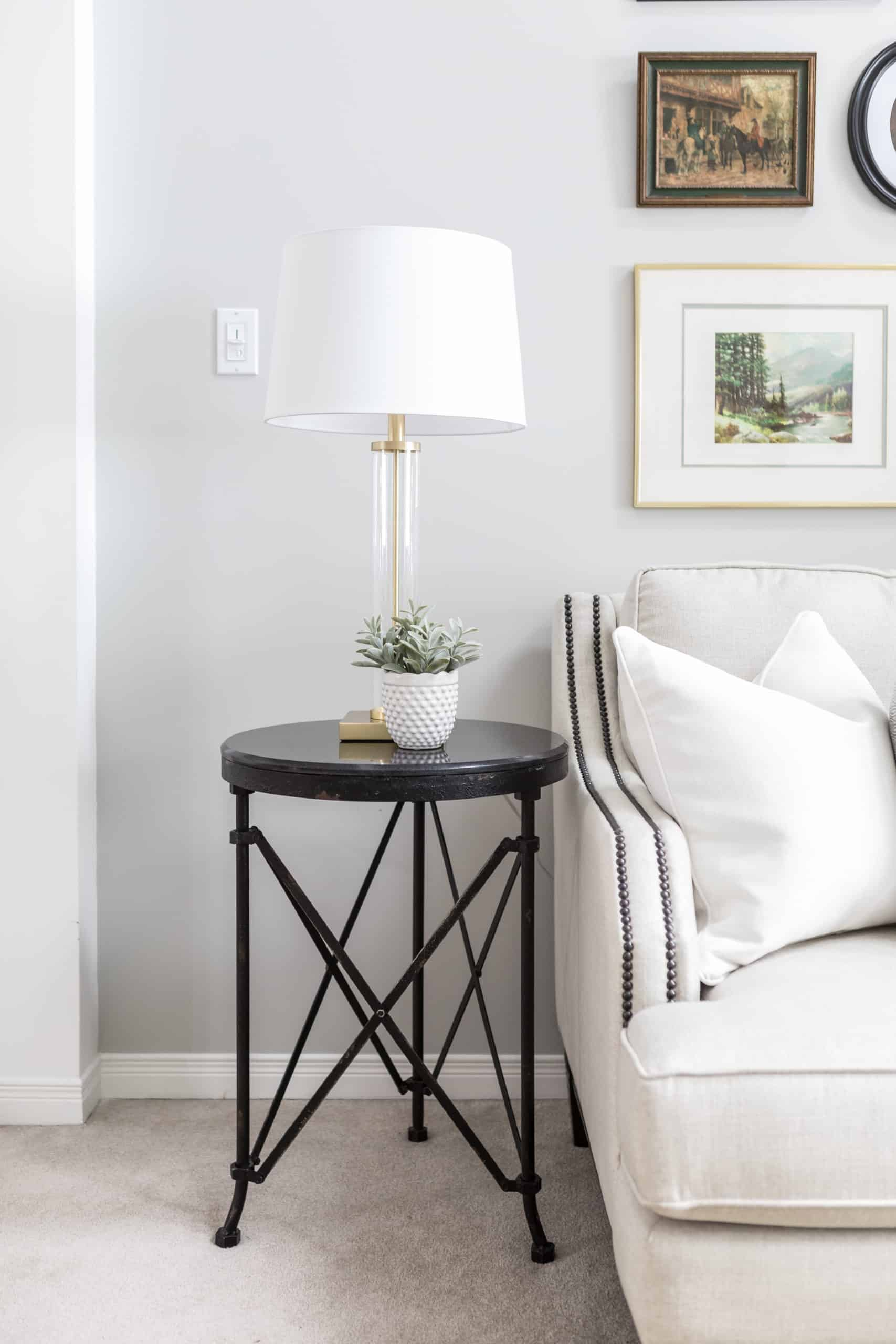 White lamp on an end table