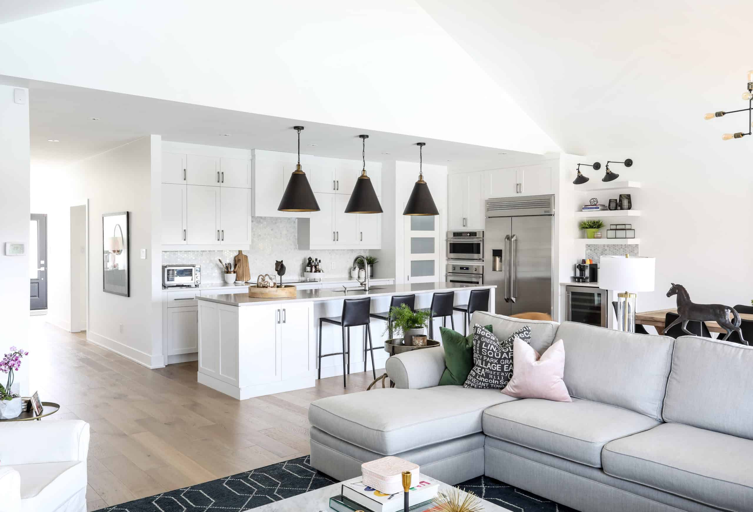 Modern kitchen with black stools at an island
