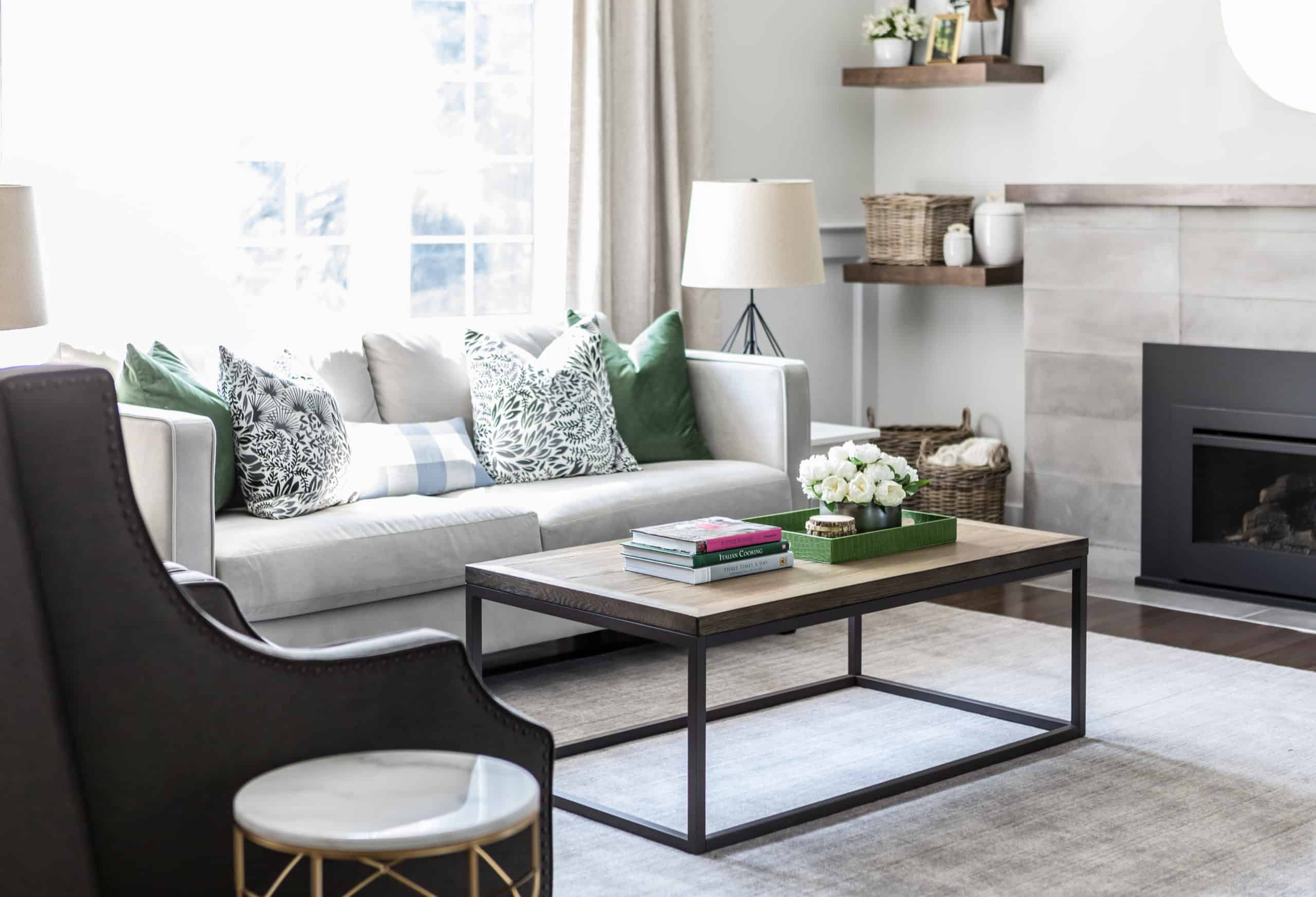 Basic coffee table inside a white and green themed living room