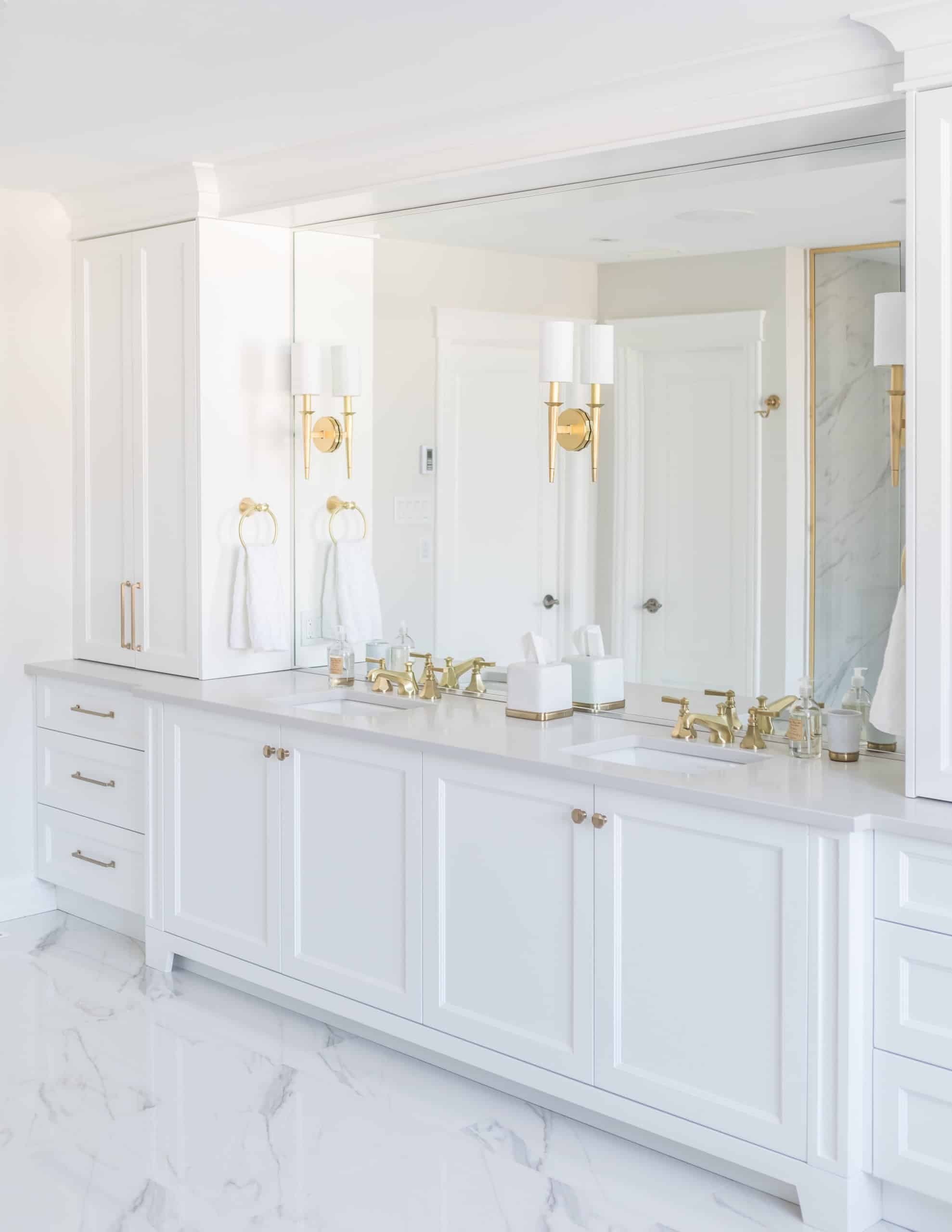 White double vanity with two golden faucets