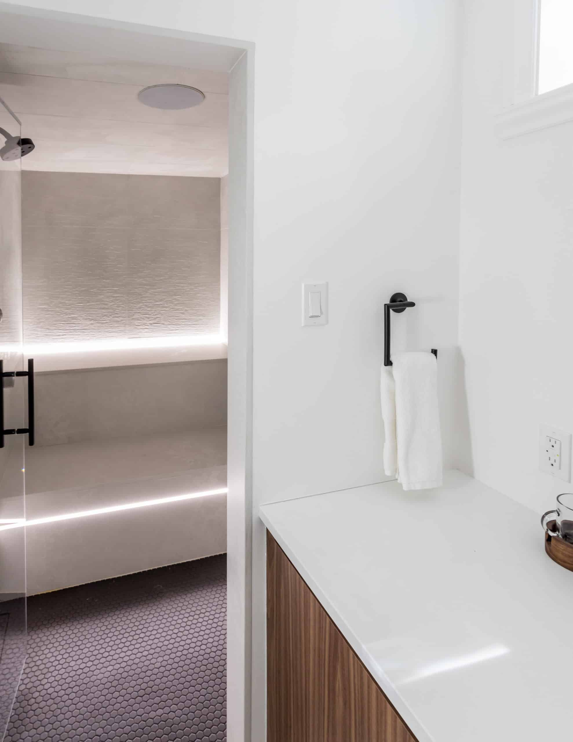 Bright white bathroom with a wooden vanity