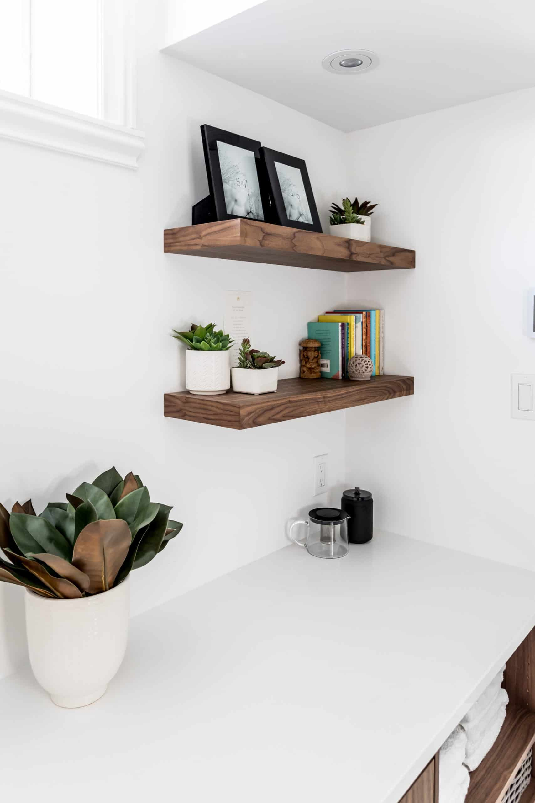 White countertop with wooden shelves in the corner